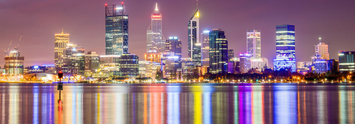 Perth city skyline from the South Perth foreshore. Perth, Western Australia, Australia. Photo taken at night. All the city lights are reflecting off the water.