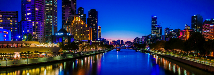Melbourne Australia. Panoramic night view over Yarra River and City Skyscrapers from Princes Bridge. Melbourne is the second most populous city in Australia and has been ranked the world's most livable city since 2011.
