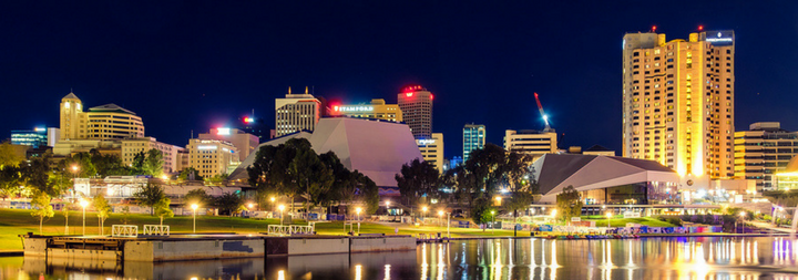 Adelaide Australia Adelaide city skyline at dusk viewed across Torrens river from King William bridge.