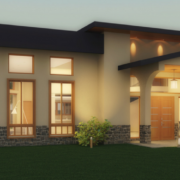Modern home at dusk. Cream walls lights at night. Green grass.