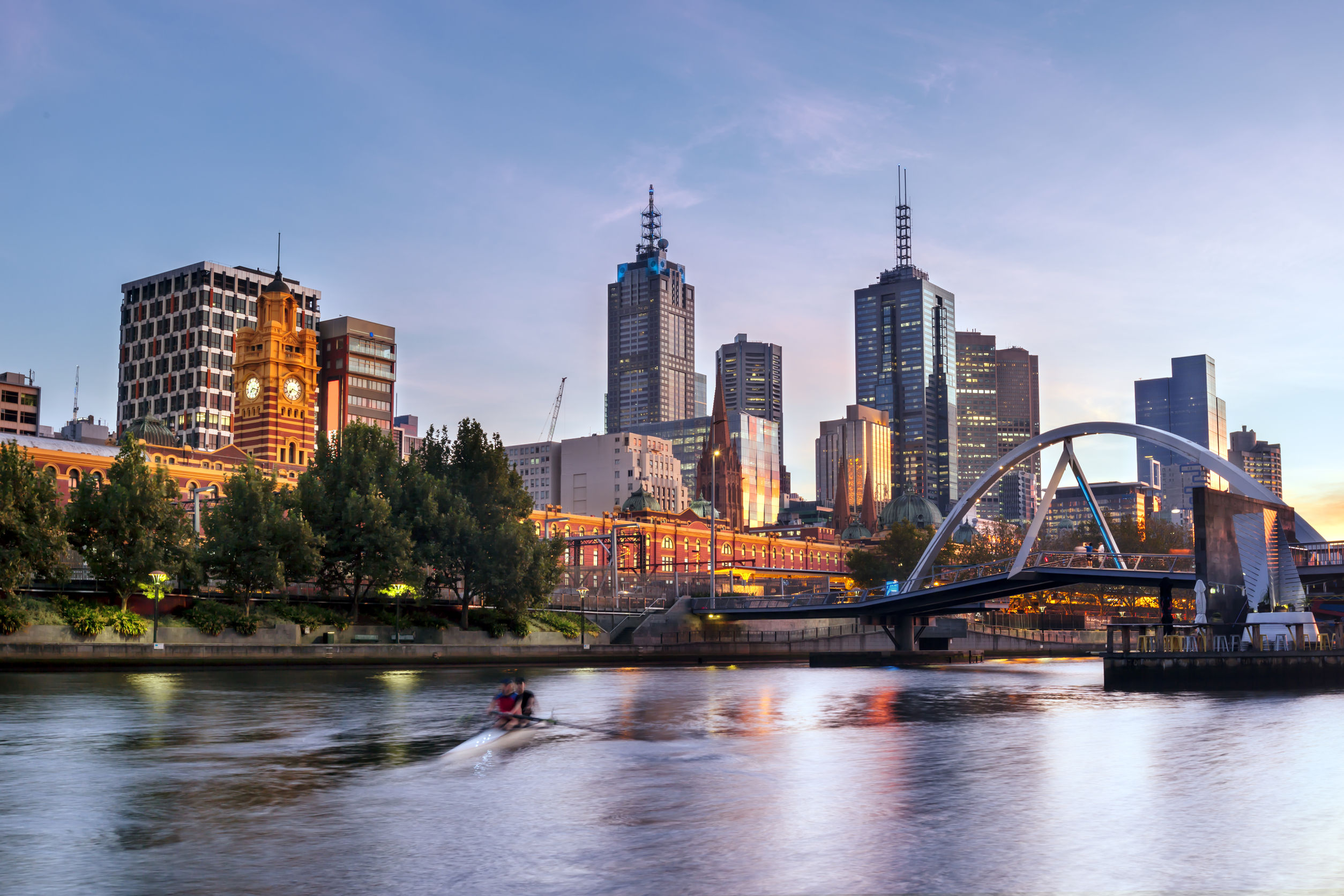 melbourne, australia, in early morning light. yarra river, towards flinders street station.
