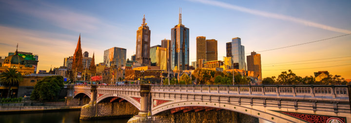 Image of Melbourne taken from the water. Beautiful old bridge running to the inner city.