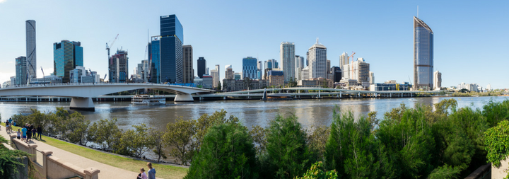 Brisbane skyline Brisbane River the Victoria Bridge and the Riverside Expressway seen from the South Bank.