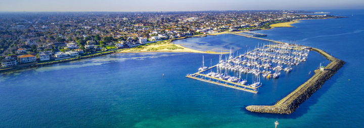 Aerial view of Middle Brighton Marina coastline and suburban area. Melbourne Australia